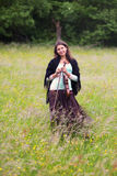 Violinist on a meadow full of flowers Royalty Free Stock Image