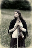 Violinist on a meadow Royalty Free Stock Image