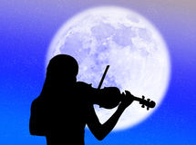 Violinist in the moon Royalty Free Stock Image