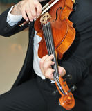 The violinist: Musician playing violin at the oper. A.Hands of musician Stock Photo
