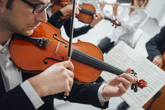 Violinist performing with music sheet stock images
