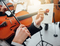 Violinist performing with music sheet Stock Photo