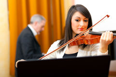 Violinist and pianist playing together Royalty Free Stock Images