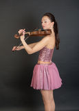 Violinist in a pink Stock Image