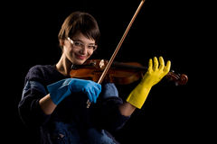 Violinist playing in gloves Stock Images