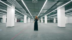 A violinist playing instrument in a room alone. 4K stock video footage