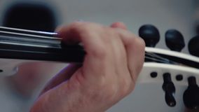 Violinist plays the violin. Closeup. stock footage
