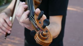 The violinist is playing on the street. Street violinist stock footage