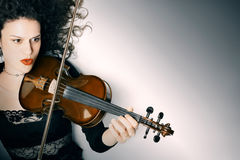 Violinist playing violin Stock Photos
