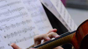 Violinist playing violin or viola in a string quartet. Musician playing viola in a string quartet on a concert stock footage