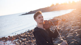 Violinist playing a violin,  young man plays on Stock Photography
