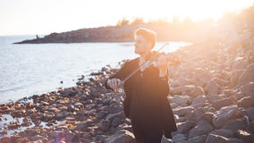 Violinist playing a violin,  young man plays on Royalty Free Stock Photo