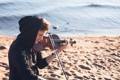 Violinist playing a violin,  young man plays on Stock Images
