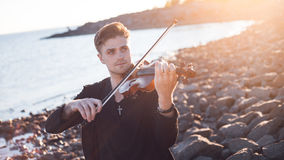 Violinist playing a violin,  young man plays on Stock Image