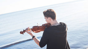 Violinist playing a violin,  young man plays on Royalty Free Stock Photography
