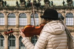 Violinist plays a beautiful wooden violin on the street of the o. Ld city Stock Photography