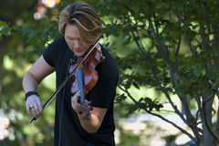 Violinist plays in Boston Public Gardens Royalty Free Stock Images