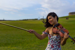 Violinist pointing Stock Image
