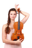 Violinist posing with violin Royalty Free Stock Images