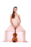 Violinist posing with violin Royalty Free Stock Photography