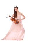 Violinist posing with violin Royalty Free Stock Photos