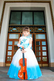 Violinist. Pretty girl in a smart dress with a violin Royalty Free Stock Photo