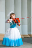 Violinist. Pretty girl in a smart dress with a violin Stock Photography