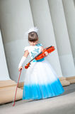 Violinist. Pretty girl in a smart dress with a violin Royalty Free Stock Images