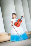 Violinist. Pretty girl in a smart dress with a violin Stock Photo