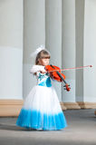 Violinist. Pretty girl in a smart dress with a violin Stock Image