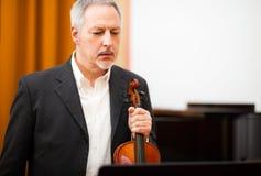 Violinist reading the score Stock Photo