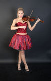 Violinist in a red dress Stock Photo