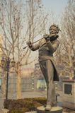 A violinist statue Royalty Free Stock Photography