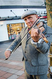 Violinist is a street musician. Royalty Free Stock Photos
