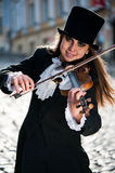Violinist and sunlight. Violinist playing on the street Royalty Free Stock Photos