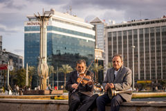 Violinist and tomtom player. Stock Photos