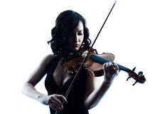 Violinist woman slihouette isolated. One caucasian Violinist woman player playing violon studio slihouette isolated in white background Stock Photography