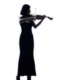 Violinist woman slihouette isolated. One caucasian Violinist woman player playing violon studio slihouette isolated in white background Stock Images