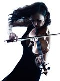 Violinist woman slihouette isolated. One caucasian Violinist woman player playing violon studio slihouette isolated in white background Royalty Free Stock Image