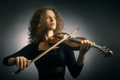 Violinist woman with violin Stock Photos