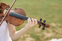 Violinist woman. Young woman playing a violin. Outside royalty free stock photo