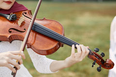 Violinist woman. Young woman playing a violin. Outside royalty free stock images