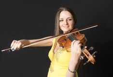 Violinist in yellow dress Stock Photography