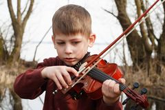 Violinist young boy outdoors stock images