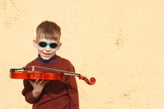 Violinist young boy playing with his violin stock photos