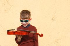 Violinist young boy playing with his violin stock photography