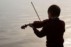 Violinist young boy outdoors royalty free stock image