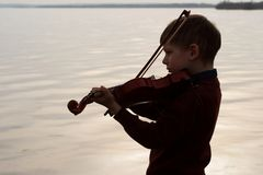 Violinist young boy outdoors royalty free stock photography