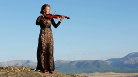 Violinist. Young Woman playing the violin stock footage