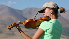 Violinist. Young Woman playing the violin stock video